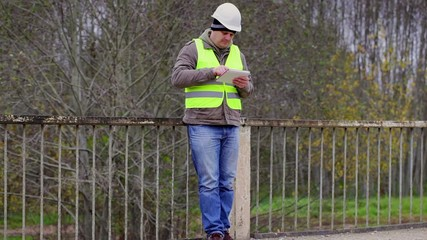 Engineer reading information in tablet PC