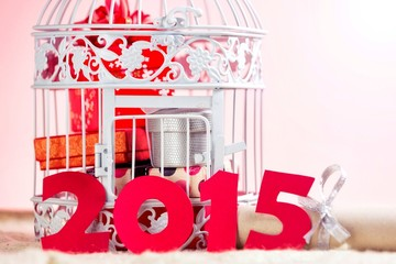 White cage with Christmas gifts and letters 2015,