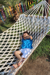 boy lying in a hammock