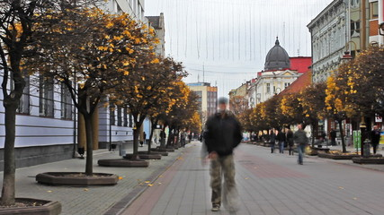 time-lapse pedestrian street in city of autumn