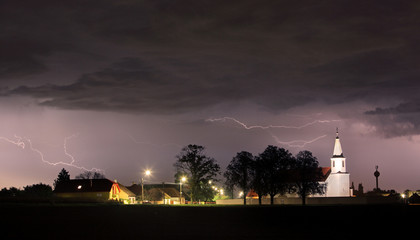 Lightning bolts over church