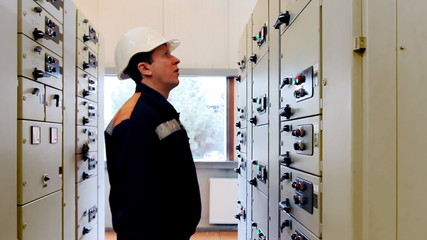 engineer activates electrical equipment from control panel