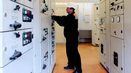 engineer unlocks and activates electrical equipment