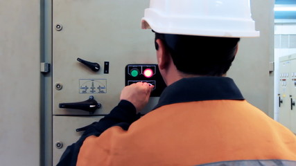 engineer turns off electrical equipment of control panel