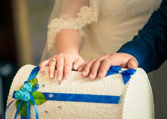 bride and groom arms on wedding treasure box