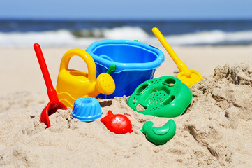 Plastic children toys on the sand beach