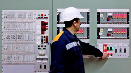 engineer comes to panel controls of gas and checks indication