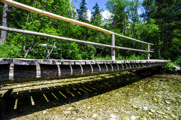 Small wooden bridge over the natural river