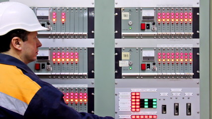 engineer checks indication on panel control of gas, closeup
