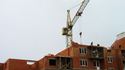 time-lapse construction activity, workers lay bricks