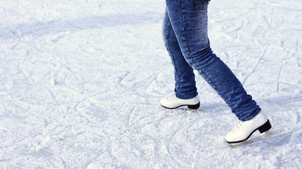 legs teenage girl drive and rotate on skating rink in winter