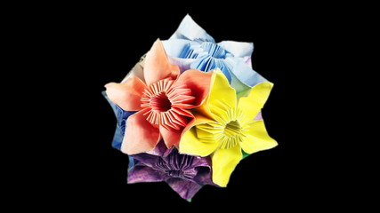rotating colorful origami kusudama, black background