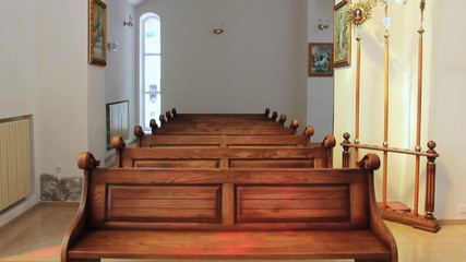 wooden benches in Ukrainian church, panorama from bottom to top