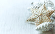 Christmas star and glass ornaments; close up