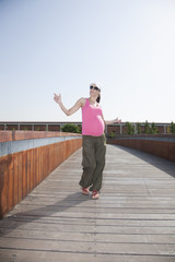 happy pink pregnant dancing
