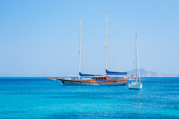 beautiful yachts in the turquoise sea on a background of mountai
