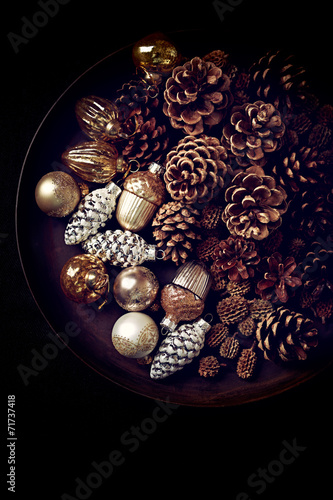 canvas print picture Pine cones and Christmas ornaments on a rustic tray