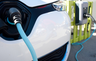 Close up of an electric car being charged