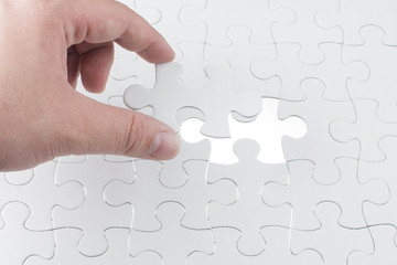 Missing jigsaw puzzle piece with light glo