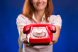 Woman with red telephone