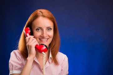 Redhead girl with red telephone