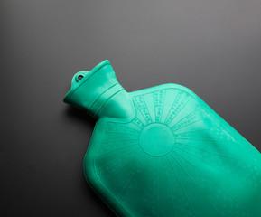 Green rubber hot water bottle