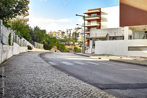 Empty street road in city with buildings - 71739035