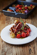 Pork ribs with baked potatoes and cherry tomatoes on a plate