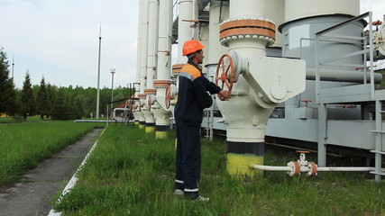 young engineer close valve of gas cleaning installation