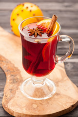 Christmas hot drink mulled wine with spices in glass
