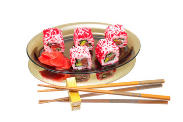 Japanese rolls on a plate on a white background with mirror refl