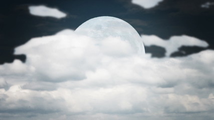 time lapse white full moon with cumulus clouds ahead at night
