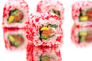 Japanese rolls with salmon and avocado on a white background