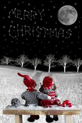 two dolls at night in Christmas time looking at the text with st
