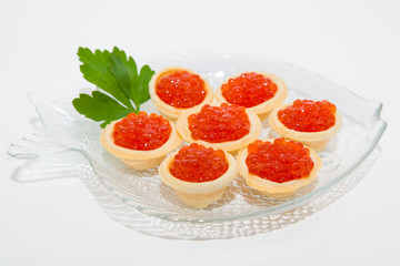 Red caviar with parsley on the plate