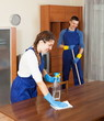 Professional cleaners working