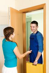 Girl meeting repairman at home