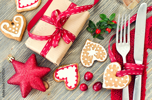 Fototapeta Christmas table setting with christmas decorations and gingerbre