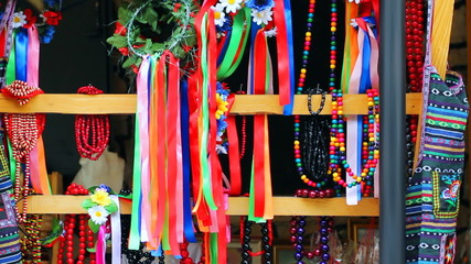 Ukrainian folk ornaments on market, wind sways colored ribbons