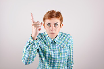 Angry threatening woman with a raised index finger