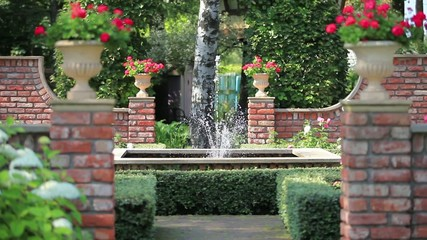 beautiful garden with a fountain