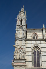 Side view of the gothic Cathedral of Siena (Italy)
