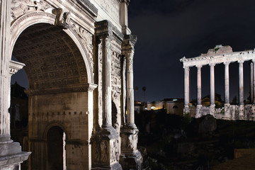 Roman Forum by night Arch of Titus, Temple of Saturn in Rome