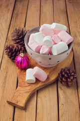 Marshmallow for Christmas dessert on wooden table