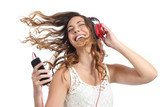 Happy girl dancing and listening to the music - 71743830