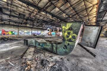 Dilapidated air duct lying on floor in an abandoned warehouse