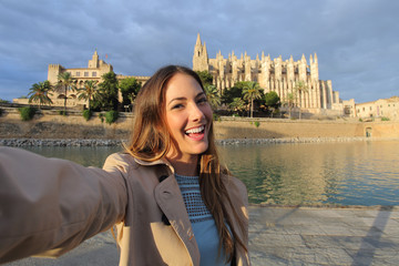 Woman photographing a selfie in Palma de Mallorca Cathedral