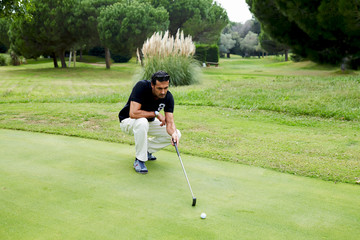 Golfer standing on the course preparing to hit golf ball