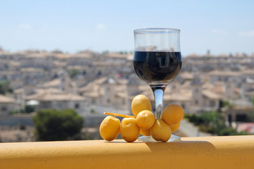 glass of red wine and dates