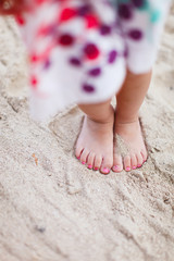 Child legs on beach